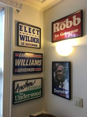 "Campaign posters line the wall in the ""Virginia room"""