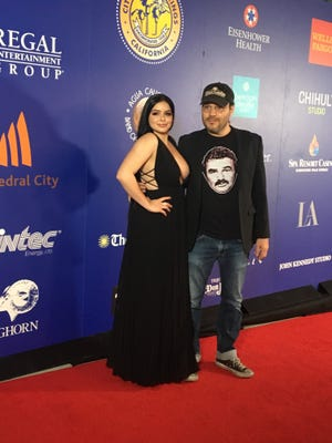 """Ariel Winter and director Adam Rifkin, of """"The Last Movie Star"""" walks the red carpet at Palm Springs High School before the screening of her movie on Jan. 14, 2018 part of the Palm Springs International Film Festival."""