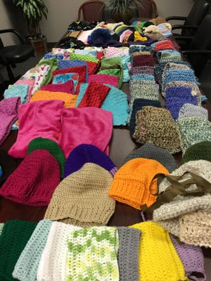 Here are some, not all, of the wonderful hats, scarves and cowls that you have knitted, crocheted and sewn for homeless people this winter.
