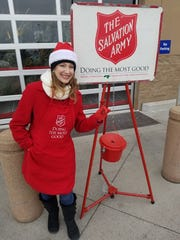 Sidney Levesque, of the Rotary Club of Abilene, volunteers to ring the bell for the Salvation Army at Sam's Club.