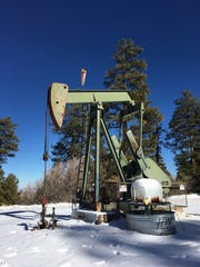 A pump jack operates at an oil site on Jan. 11 on Ch'ooshgai