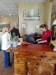 Ida Schabani greets customers at her new Friendship Diner.