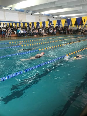 Marion Harding's Madison McKinniss, second from right, competes in the 100-yard backstroke at Saturday's Mid Ohio Athletic Conference Swimming Championships at Ontario.