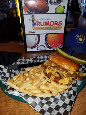 One of the signature items at Rumors is the Rumors Burger: A half-pound fresh angus patty topped with Texas toothpicks, bacon, pepper jack cheese and chipotle aioli.