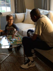Kasey Vogel 's daughter, Quincey, plays a game with her grandfather, Charlie.
