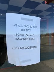 A sign on the front doors of Icon Cinema in San Angelo