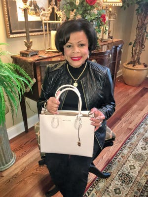 Go Red – The Go Red Luncheon is coming up February 16 and handbags are arriving daily for the fabulous silent auction of incredible purses. We caught up with Dr. Mureena Turnquest-Wells holding a beige (or maybe stone?) Michael Kors, perfect for the upcoming spring weather we are all waiting patiently for. The Go Red event benefits the American Heart Association and its title sponsor is Deaconess Heart Hospital.