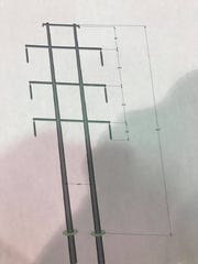 The revised power line tower design features two poles,