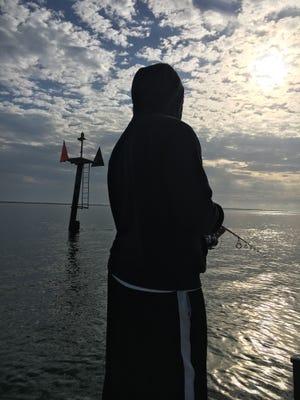 Ethan enjoying fishing on a cool morning on the Treasure Coast