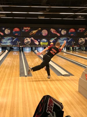 Marion Harding's Kameron Hall competes against Pleasant in a boys bowling match Monday at bluefusion entertainment.