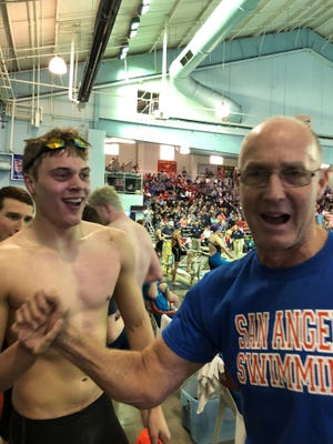 San Angelo Central High School head swimming coach David Hague celebrates with senior Ryan Brown after the Bobcats set a new pool and regional record in the boys' 200 freestyle relay at the Region I-6A Championships in Lubbock on Saturday, Feb. 3, 2018.