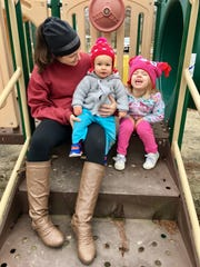 Travel and tourism reporter Leigh Guidry sits with her daughters on the day use playground at Bayou Segnette State Park in Westwego.