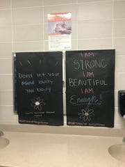 Posters in middle school  girls restrooms offer a message