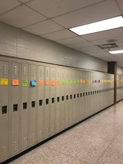 Lockers sport notes of encouragement during We Stand