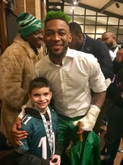 Philadelphia Eagles cornerback Jalen Mills with Newark's Joseph Martuscelli, 9, following Super Bowl LII.