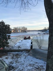 Workers remove diesel fuel contaminated ice and debris from Lake Hopatcong in New Jersey following a Feb. 4 report of a spill that state officials say likely came from a nearby construction firm.