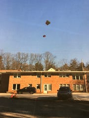 Balloons hoisted over a building on Chatham Road in