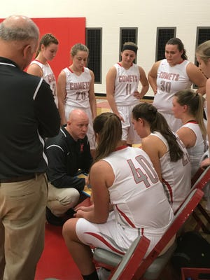 Elgion girls basketball coach Bob Douds talks to his team during a timeout earlier this season. The Comets won the Northwest Central Conference in their first season in the league.