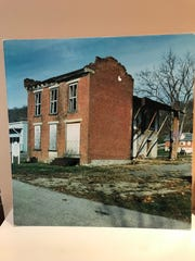 A photograph on display at the John P. Parker House in Ripley, Ohio, shows how the house appeared in the early 1990s before it was restored and turned into a museum