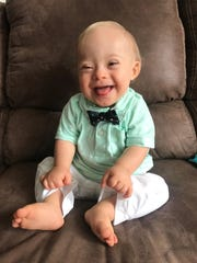 "This September 2017 undated photo provided by the Warren family via Gerber shows 14-month-old Lucas Warren of Dalton, Ga. Lucas' contagious smile won over executives at Gerber baby food who have made him their ""spokesbaby"" this year. Lucas is Gerber's first spokesbaby with Down syndrome in the company's 91-year history. (Courtesy Warren family/Gerber via AP)"