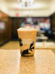 Black milk tea with grass jelly from Grumpy Bobas.