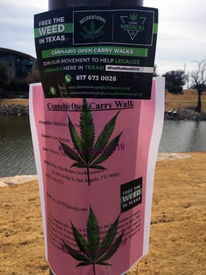 A flyer for an open carry rally in support of cannabis hangs on a pole by San Angelo's river-walk. Feb. 1, 2018