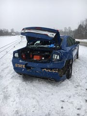 A Michigan State Police trooper was injured in a crash Friday afternoon.