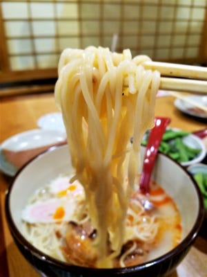 Tonkotsu ramen is a rich-yet-delicate version, made with a broth of pork and chicken that has been rapidly boiled until it reaches a creamy thickness.