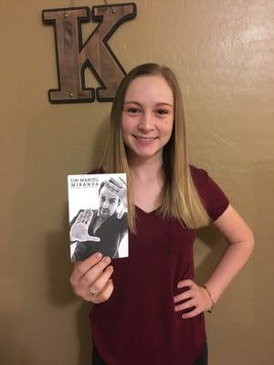 "Sixteen-year-old Madasyn Kaylor of Surprise, Arizona, shows off a handwritten postcard from ""Hamilton"" creator Lin-Manuel Miranda."