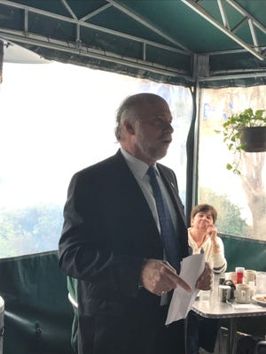City Commissioner Gil ZIffer addresses Progressive Democrat group at Uptown Cafe Tuesday