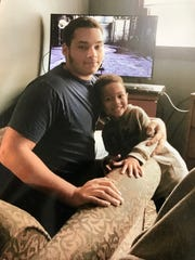 Adam Trammell, shown here with his nephew, died after being tased by West Milwaukee police in May 2017.
