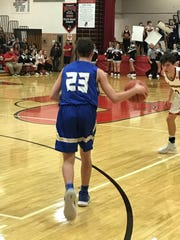 Ontario's Griffin Shaver brings the ball up the court
