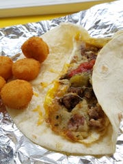 Don't miss the breakfast taco at Zesto. The potatoes are freshly griddled, the egg fried to order, and the whole package griddled until hot and melty.