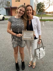 Abby Brafman and her mom, Suzanne, holding up certificate