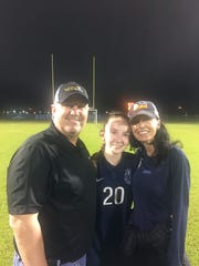 Former ESA soccer star Robby Leger, left, with daughter Piper and former ESA soccer coach and wife Dione.