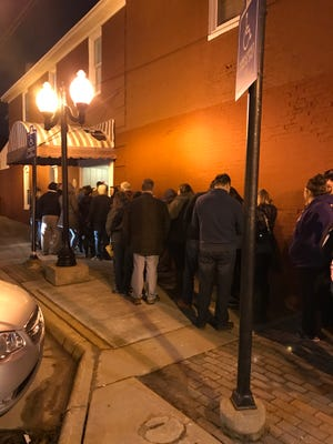 A line stretches around the block to get in to the Yum Yum Tree Friday, Feb.23, a longtime Brighton favorite that owners say is about to close.