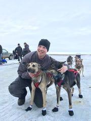 Matt Scott with his team of Alaskan huskies after they