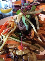 "The filet and frites at Rising Tide was a decent piece of meat atop hand-cut fries (frites) accompanied with colorful ""matchstick"" vegetables, a ""chimi chimi bang bang demi,"" crème and corn hay."