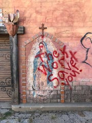 An unknown person or persons vandalized religious iconography with spray paint at Paintbrush Alley. Feb. 26, 2018.