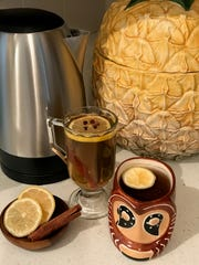 These hot toddy recipes include citrus, hot water and whiskey or rum.