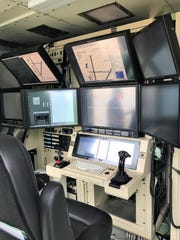 To launch and recover the unmanned aircraft systems, a virtual cockpit is used by crew members.