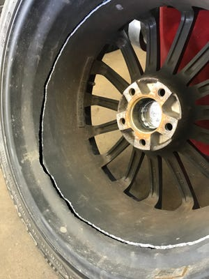 A rim sliced through this tire at Best One of Indy at 2646 E. 62nd St., shown Saturday, March 3, 2018. The damage was caused by potholes that have riddled Indianapolis' streets this winter.