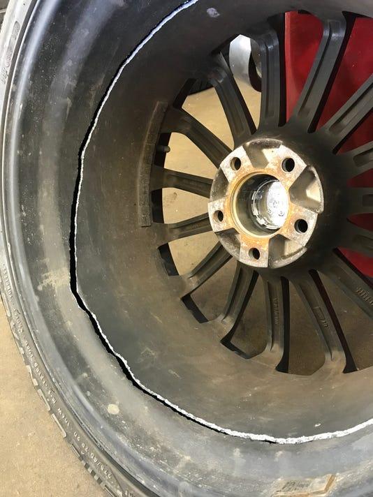 indystar stock pothole stock pothole damage stock damaged rim stock damaged tire stock tire damage stock tire