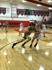 Newark Catholic's Heath Jeffries tries to drive by