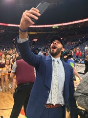 Lansing's Drew Valentine is an assistant coach at Loyola-Chicago, which reached the NCAA tournament for the first time in 33 years by winning the Missouri Valley Conference tournament on Sunday.