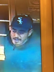 One of two persons of interest being sought by police in relation to a robbery at the Aguitas Bar & Grill in Sparks.