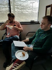 Courier staffers Noah Stubbs, left, and Kyle Sokeland, right, thoughtfully devoured chicken from six locations.