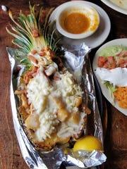 Fajitas Hawaiianas make their stunning appearance in a pineapple shell. Chicken fajitas are enhanced with ham, pineapple, and cheese.