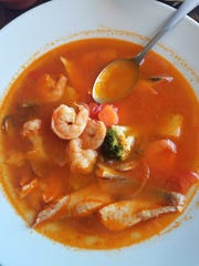 Light eaters will enjoy Herradura's soups, such as this seafood both with shrimp, tilapia and lots of veggies in a light broth.