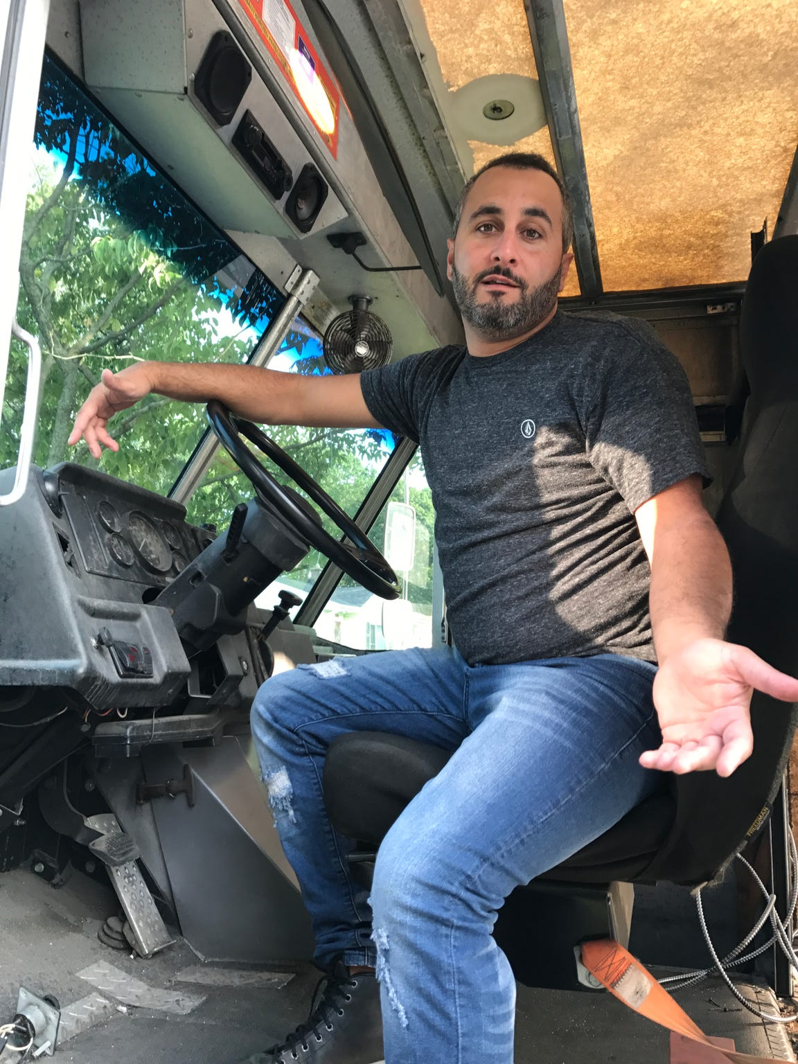 Joe LoPresti sits in his unfinished food truck after he pulled it from M Design Vehicles.